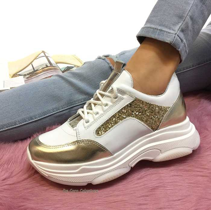 Sneakers oro con zeppa alta donna